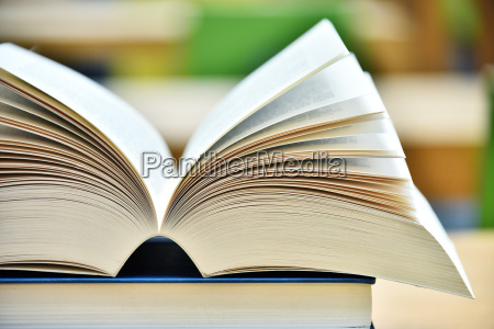 books lying on the table in