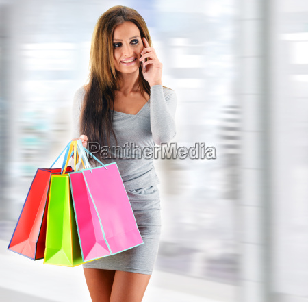 young, woman, with, bags, in, shopping - 22652037
