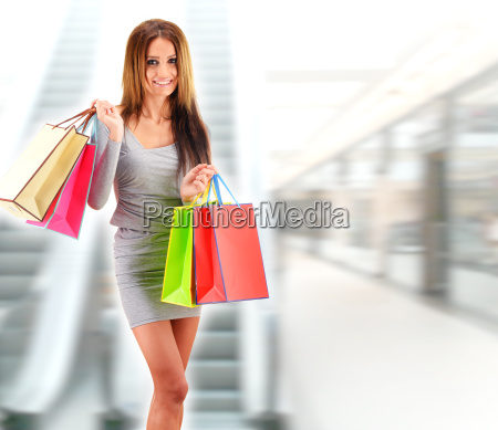 young, woman, with, bags, in, shopping - 22652041