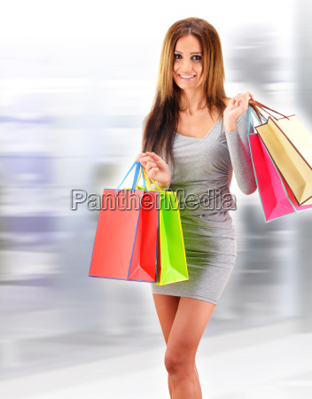 young, woman, with, bags, in, shopping - 22652043