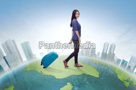 traveler, asian, woman, walking, carrying, suitcase - 22653309