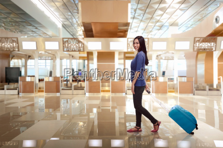 young, asian, woman, passenger, with, luggage - 22653311