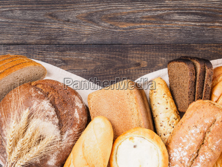 bread assortment on brown wooden background