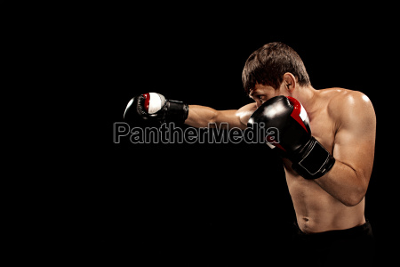 male, boxer, boxing, in, punching, bag - 22657771