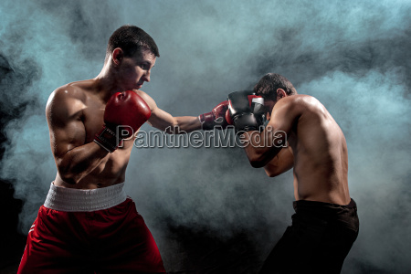 two professional boxer boxing on black