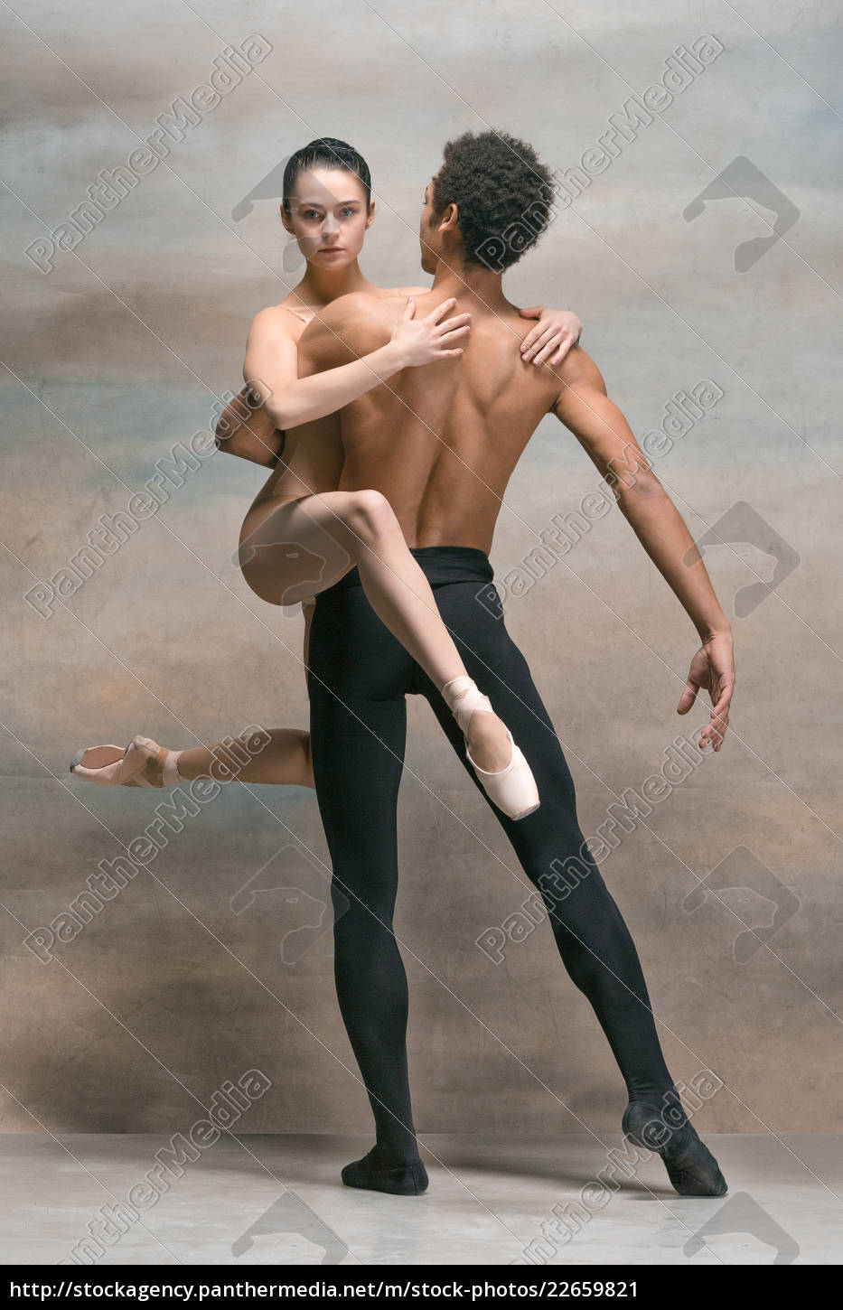 couple, of, ballet, dancers, posing, over - 22659821