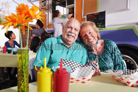 smiling, elderly, couple, eating, out, from - 22661731