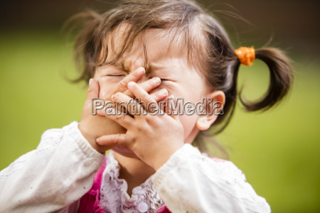 baby girl playing and putting hands