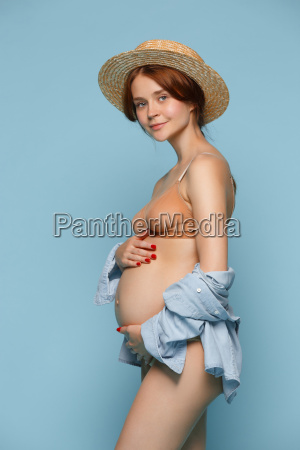 young beautiful pregnant woman standing on