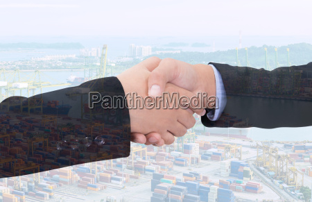 business handshake with city background double