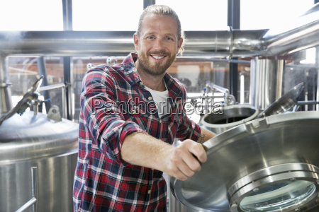 portrait of male brewery worker checking