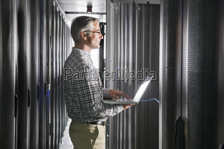 service technician with laptop working in