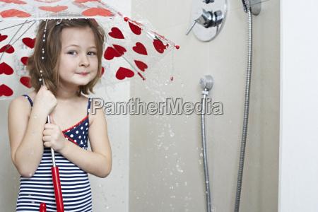 portrait of smiling little girl taking
