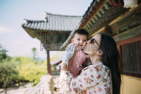 south korea gyeongju womankissing a baby