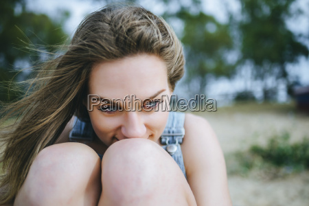portrait of daydreaming woman sitting on