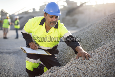 quarry worker doing a quality check