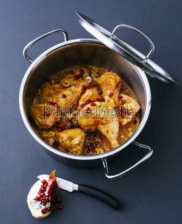 cooking pot of prepared chicken in