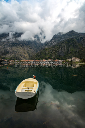 a small fishing boat sits in
