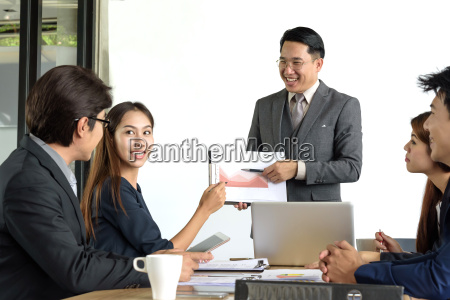 asian, businessman, present, financial, chart, with - 22694973