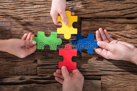 hands holding jigsaw puzzle