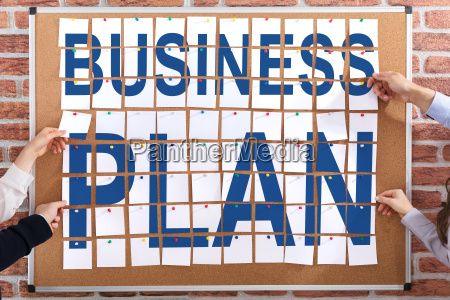 business plan written on paper notes