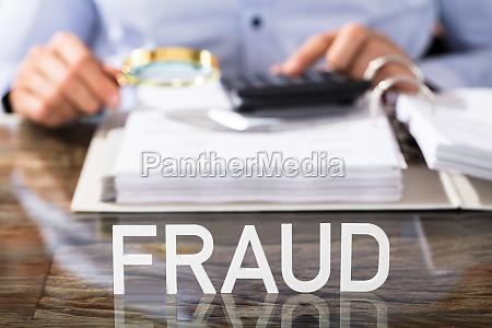 fraud text on office desk