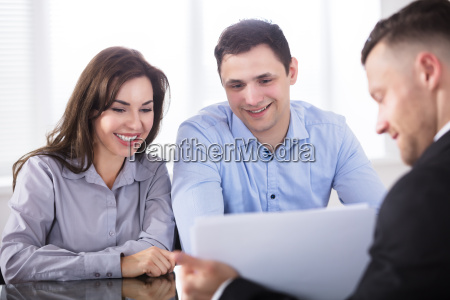 couple having discussion with advisor in