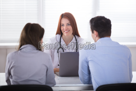 couple sitting in front of female