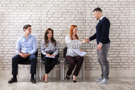 applicant, shaking, hands, with, businessman - 22695573