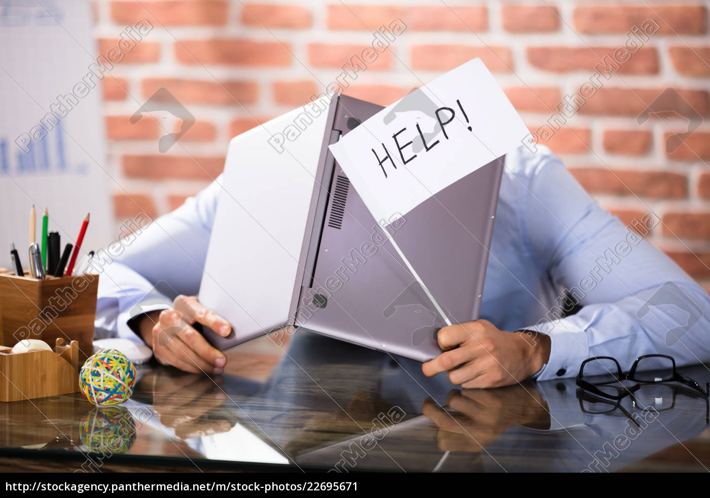 businessman, covering, his, head, with, laptop - 22695671