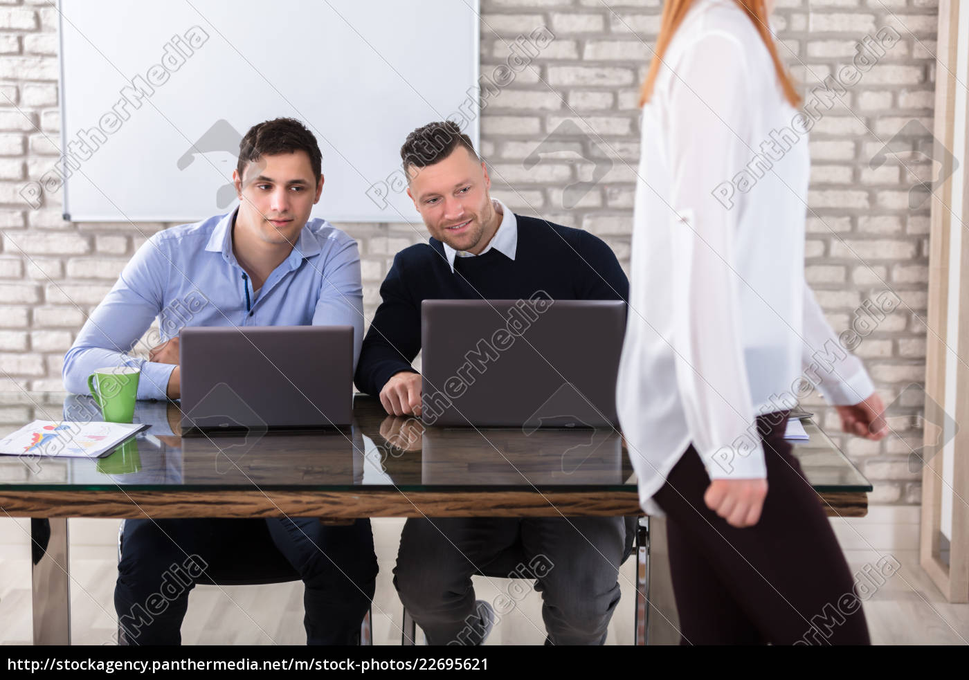 businessmen, looking, at, woman - 22695621