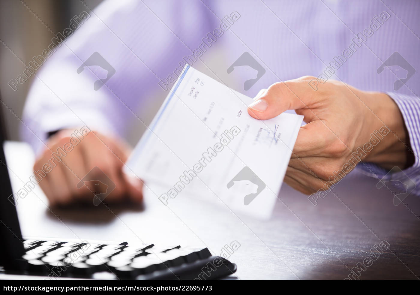 businessperson's, hand, holding, cheque - 22695773