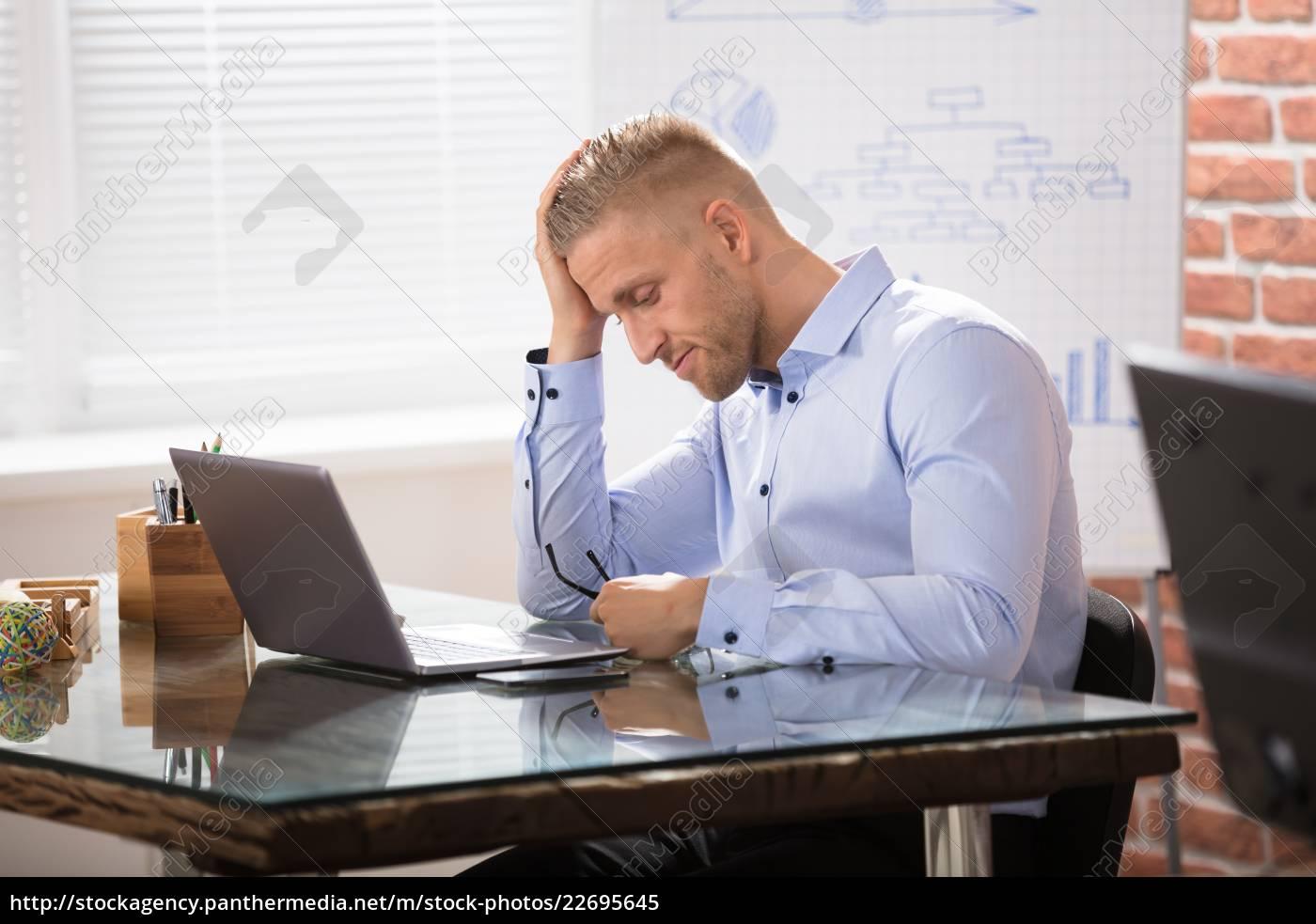 depressed, businessman, with, laptop - 22695645