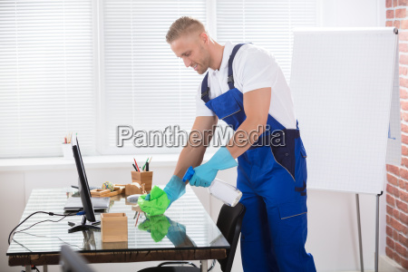 janitor, cleaning, desk, with, cloth, in - 22695737