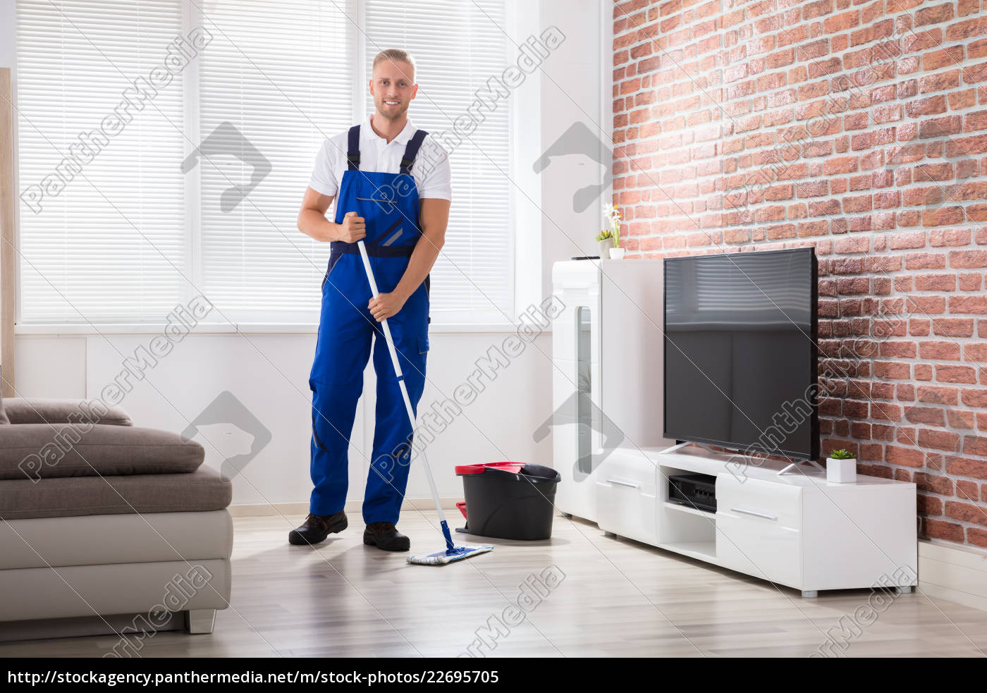 male, janitor, sweeping, floor, at, home - 22695705
