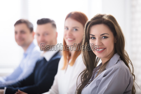 smiling, woman, with, her, colleagues - 22695559