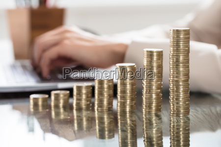 stack, of, increasing, coins, on, office - 22695959