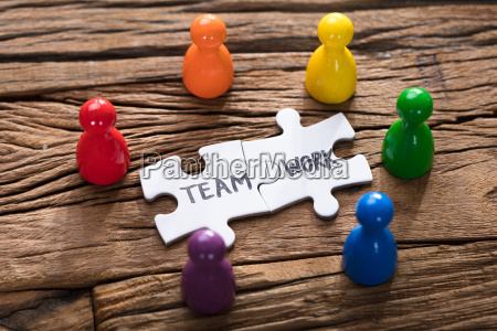 teamwork jigsaw pieces surrounded by colorful