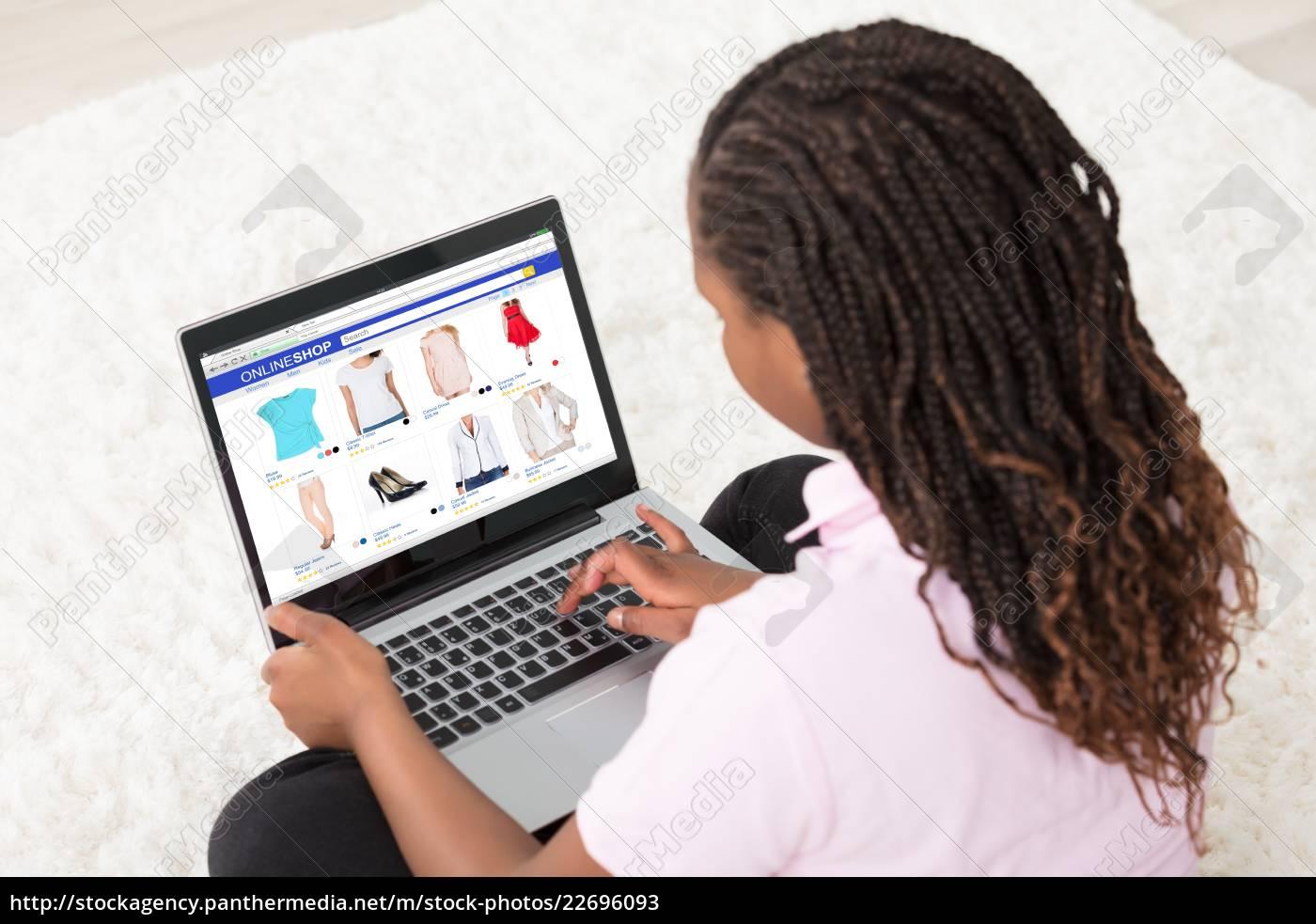 african, girl, doing, online, shopping - 22696093