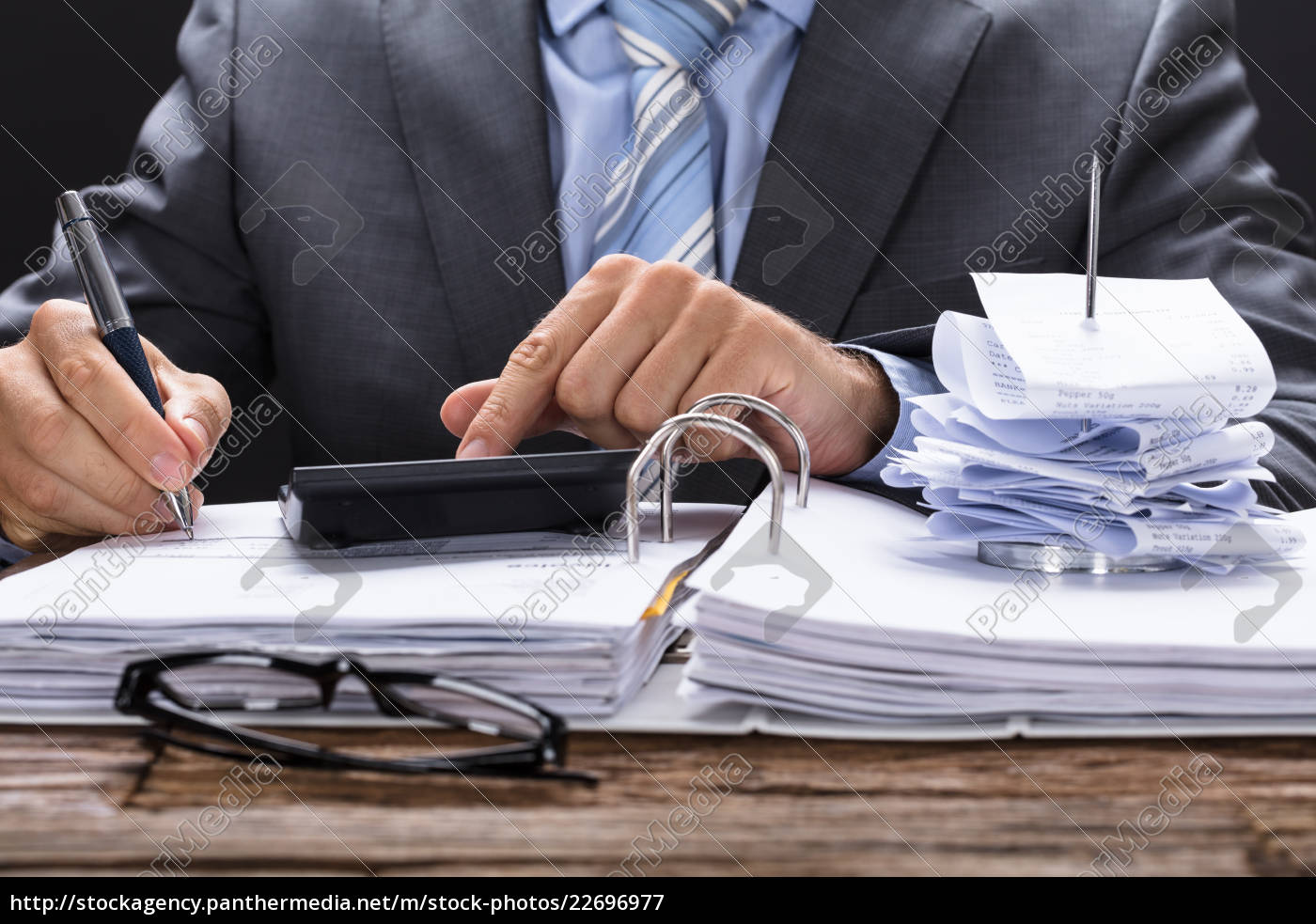 businessman, calculating, invoice, with, bill, stand - 22696977
