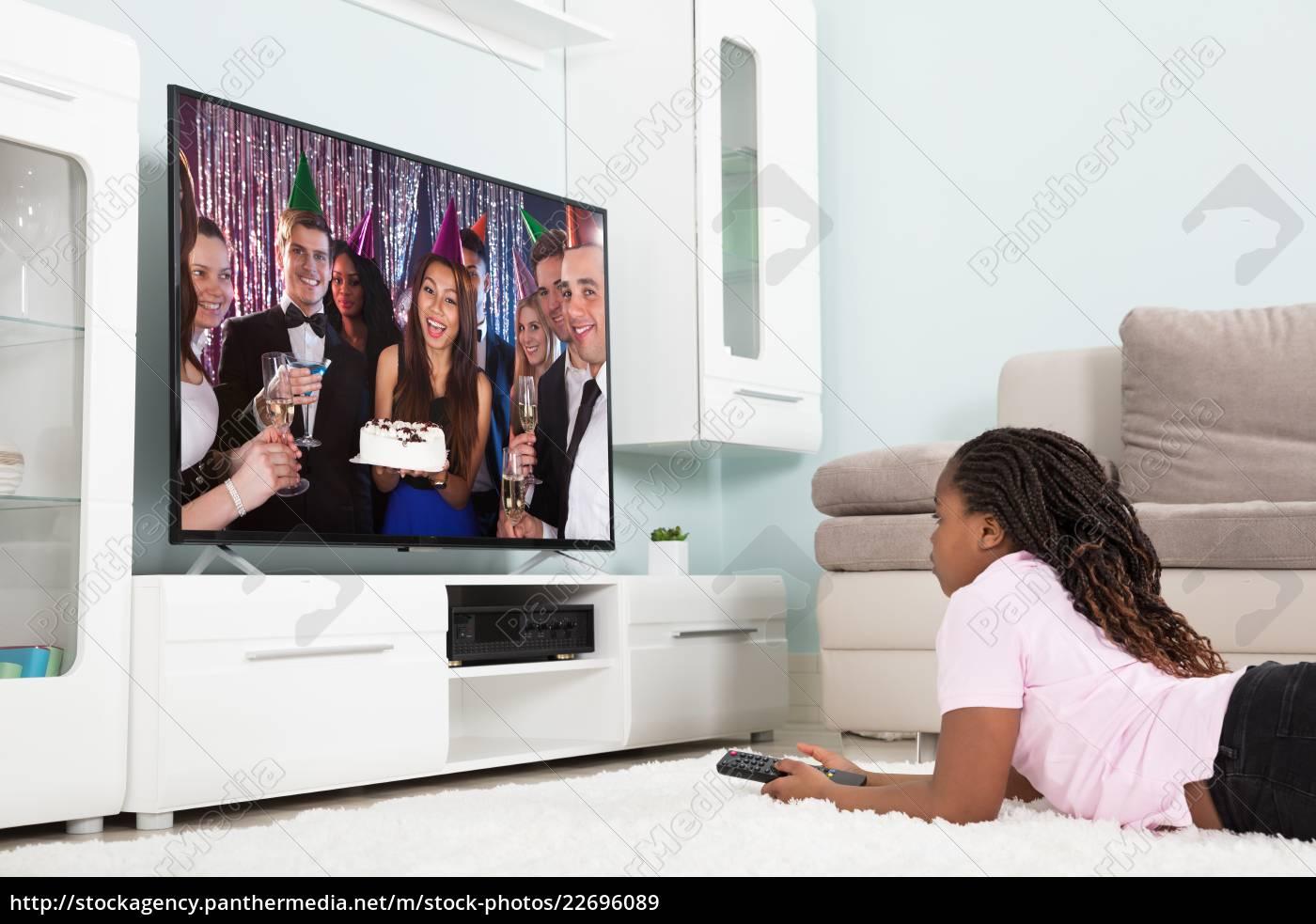 girl, watching, television, at, home - 22696089