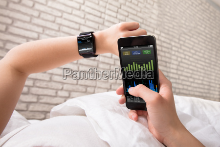 hands, with, smart, phone, and, watch - 22696799