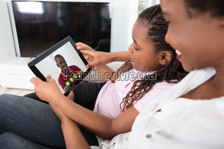 mother, and, daughter, video, conferencing, on - 22696085