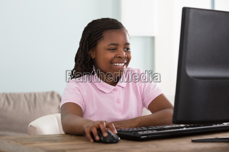smiling, girl, using, computer - 22696047