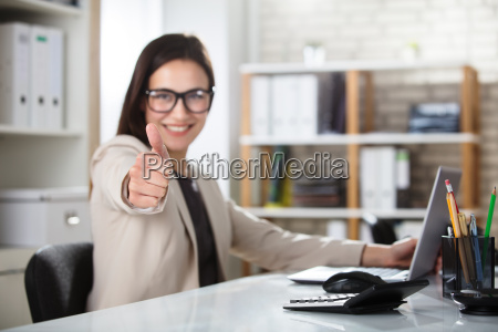 smiling, young, businesswoman, showing, thumbs, up - 22696717