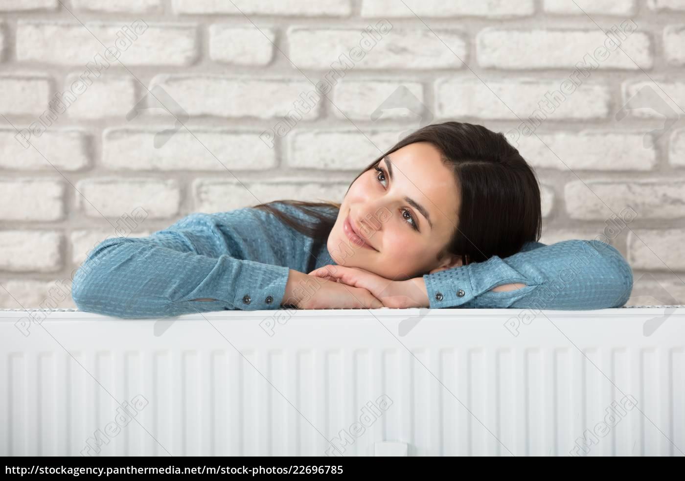 woman, behind, the, heating, radiator - 22696785