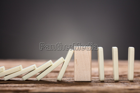 wooden, block, amidst, falling, and, upright - 22697037