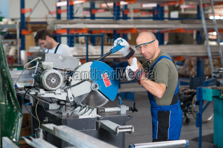 worker, with, thumb, up, in, factory - 22698691