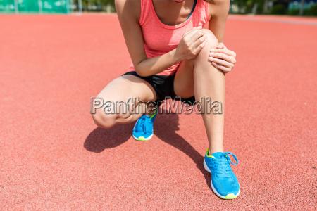 woman feeling pain on knee