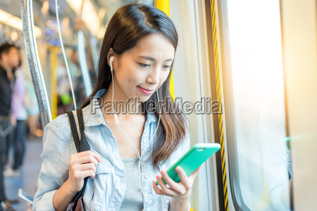woman listen to music on phone